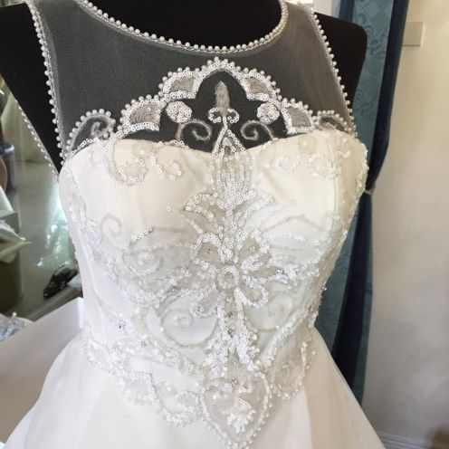 Close-up of bead and lace work for a wedding dress.