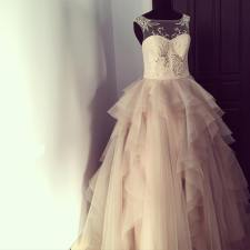 Ball gown featuring a beaded illusion neckline top and a flounced skirt.