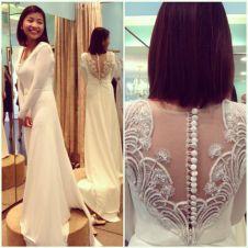 Long-sleeved illusion back wedding dress.