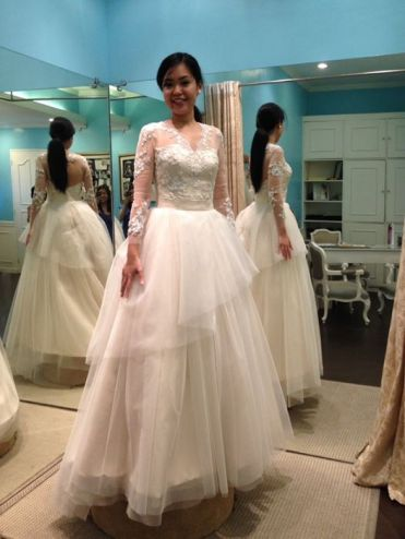 Wedding ball gown with a full tulle skirt and a lace bodice.