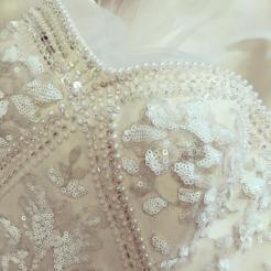 Close-up of lace and bead work detail.