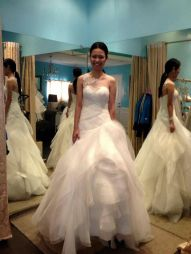 Asymmetrical wedding gown made of soft tulle and organza.